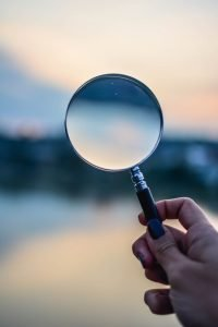 Selective Focus Photo Of Magnifying Glass